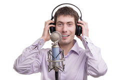 Man singing into microphone Stock Photography