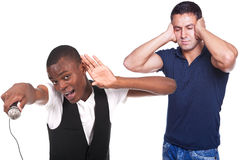 Man singing and other with headache Stock Photo