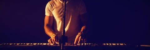 Man singing while playing piano at club. Man singing while playing piano at nightclub Royalty Free Stock Photos