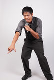 Man singing and pointing to his fans Royalty Free Stock Photography