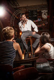 Man singing on stage in bar Stock Photography
