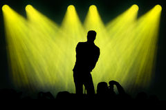 Man Singing On Stage Under Spots Stock Image