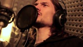 Man singing in the Studio stock video