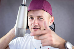 Man singing in the studio Royalty Free Stock Photo
