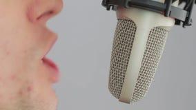 Man singing at studio microphone stock video footage