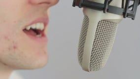 Man singing at studio microphone stock video