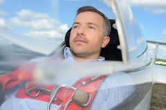Man in single seater aircraft. Single royalty free stock photography