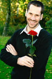 Man with a single stalk of rose Royalty Free Stock Images