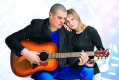 Man sings girl on guitar Royalty Free Stock Images