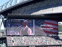 Man sings God Bless America on digital screen. SEATTLE - JUNE 26: Man sings God Bless America on digital screen during baseball game at Safeco Field, Seattle in Royalty Free Stock Images