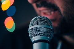 Man sings karaoke in a bar Stock Images