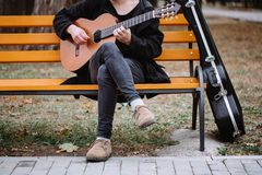 Music in park. Man sit on bench and compose music in park stock photos