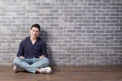 Man sit with brick wall Royalty Free Stock Photos