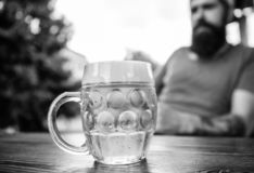 Man sit cafe terrace enjoying beer defocused. Alcohol and bar concept. Creative young brewer. Craft beer is young, urban royalty free stock images