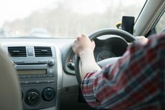 Man sit in the car hand is driving the car on the road. travel to He is looking to a road traffic route and listening to music. Happily royalty free stock photos