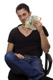 Man sit on chair and hold money Royalty Free Stock Photo