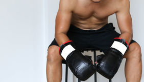 Man sit down resting on doing boxing excercise Stock Photography