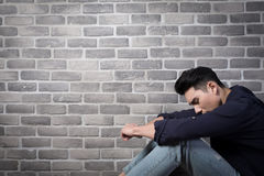 Man sit and feel depressed Stock Photos