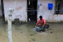 A man sit in front of his flooded house. An unidentified man sit in front of his flooded house on August 21,2018 in Chengannur, Kerala, India. Kerala was badly royalty free stock photo