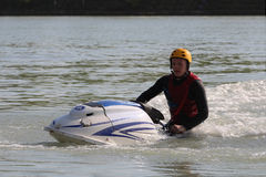 A man sit on the jet ski. Royalty Free Stock Photography