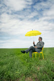 Man sit in a meadow Stock Photography