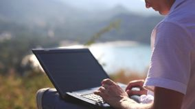 Businessman sits on the rock working on laptop. 1920x1080. Man sit on the rock working on laptop. 1920x1080, hd stock video footage