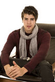 Man sit with scarf looking Stock Images