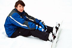 Man sit on snow and preparing to ride royalty free stock photography