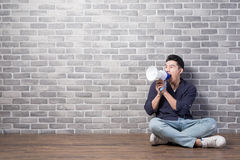 Man sit and take microphone Royalty Free Stock Photo