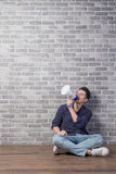 Man sit and take microphone Stock Photo