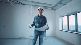 Man on a site with blueprint Royalty Free Stock Photos