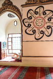 Man sits in an alcove of the mosque Royalty Free Stock Images