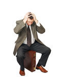 Man sits on the bag and seized hands for the head Stock Photography