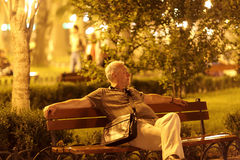 Man sits on bench Royalty Free Stock Photo