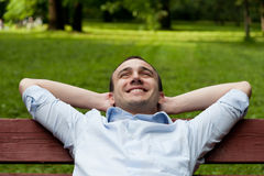 Man sits on bench Stock Image