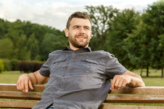 Man sits on the bench and relax Stock Image