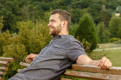 Man sits on the bench and relax Royalty Free Stock Photo