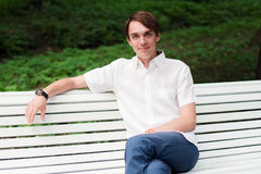 The man sits on a bench Stock Image