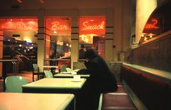 Man sits in cafe. Man sits alone in cafe Royalty Free Stock Photo