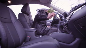 Man sits in the car and puts a rose in seat. stock video