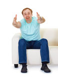 Man sits on couch in despair Royalty Free Stock Photos