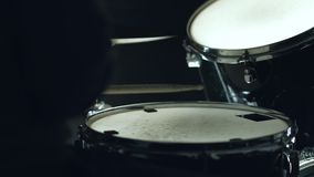 Drummer plays the drums. Man sits down to play the drum set stock video footage