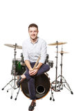 Man sits on drums Royalty Free Stock Images