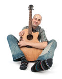 Man sits with a guitar Stock Images