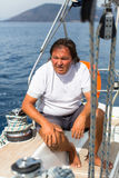 A man sits on his sailing yacht. businessman Royalty Free Stock Image