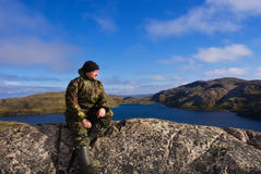 Man sits on a mountain top. Ridge Musta Tunturi. Stock Images