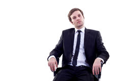 Man sits in office chair Royalty Free Stock Photos