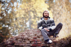 The man sits on an old bricklaying. Royalty Free Stock Photo