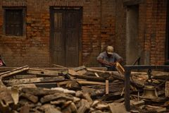 A man sits outside his now earthquake ruined house in Bhaktapur, Royalty Free Stock Photography