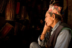 A man sits quietly with his duaghter in Kathmandu, Nepal Royalty Free Stock Photo